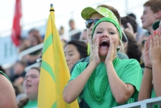 Senior Kylie Wheeler yells a chant during the scrimmage against Charlestown.