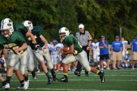 Sophomore Devon Stikes runs the ball up the middle.