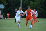 Sophomore Brandon McGeorge fights to steal the ball from the Columbus East player.