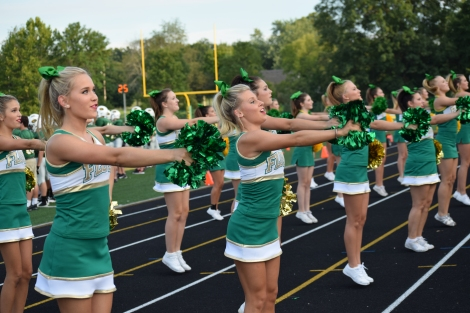 The cheerleaders get the crowd excited for the game.