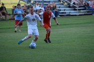 Senior Sean Brown passes the ball to another player.