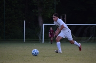 Senior Tyler Thulier chases after the ball.