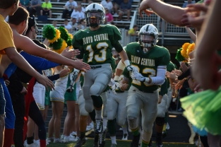The football team rushes out of the student section tunnel.
