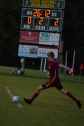 Senior Jack Parker kicks the ball out of the zone.