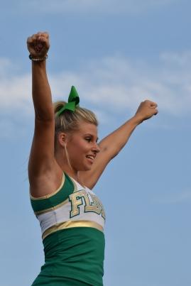 Junior Olivia Babbitt stunts in the air.
