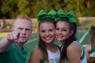 Senior Hunter Hampton, junior Kendall Kasier, and senior Skyler Nardi pose for a picture during the game.
