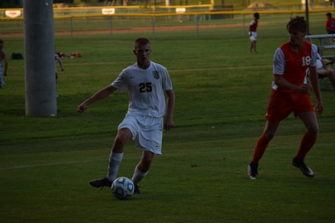 Sophomore Jason Forbes dribbles the ball towards the net.