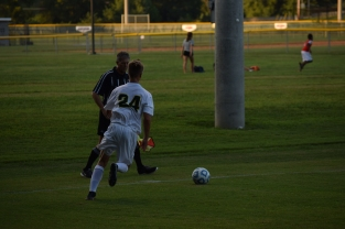 Freshman Riley Thompson chases after the ball as it moves down the sideline.