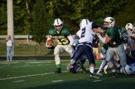 Senior Blake Carl rushes the ball.