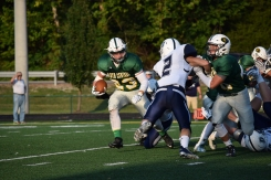 Senior Blake Carl rushes the ball.