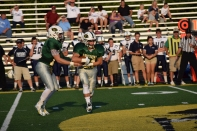 Senior Kyle Peters hands the ball off to junior Colt May.