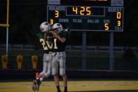 Junior Dylan McRae and sophomore Matthew Weimer celebrate after scoring a touchdown.