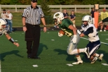 Junior Colt May breaks the tackle of a Providence defender.