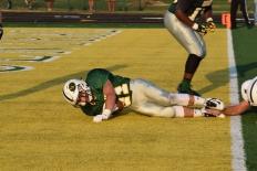 Junior Colt may scores a touchdown.