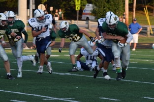 Senior Blake Carl breaks the tackle of a Providence defender.