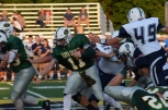 Senior Kyle Peters rushes the ball up the middle.