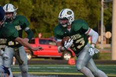 Senior Blake Carl runs the ball.