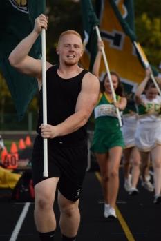 Senior Hunter Hampton carries a FC flag.
