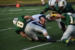 Junior Trevor Clark tackles a Providence player.