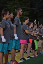 Junior Emily Dutrow, senior Yuriko Tashiro, and junior Cameron Graves prepare to lead the marching band.