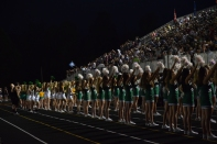 The Dazzlers and cheerleaders pump up the crowd.