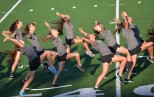 The color guard moves in as one synchronized group after weeks of practice.