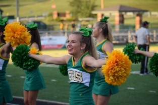 Junior Jenna Elsby cheers on the sidelines during the scrimmage against Charlestown.