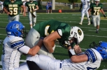 Junior Bradley Philpot is tackled by two Charlestown players.