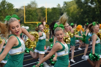 Senior Lindsey Smallwood and junior Olivia Babbitt cheer on the sideline.