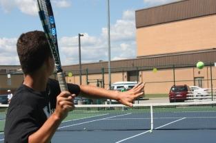 Junior Evan Saylor hits the ball.