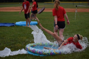 "Senior Kylie Wheeler slides into first base while playing ""kiddle pool kickball"" at the FCDM tailgate before the football game against Seymour."