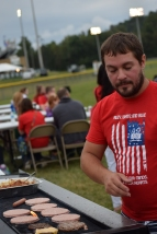 English teacher Matthew Townsend grills at the FCDM tailgate.