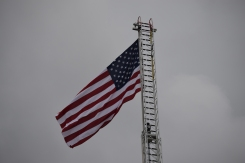 Georgetown fire engine L-2 raises the American flag on its ladder.