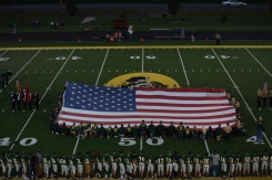 Members of the FC NJROTC, armed forces, veterans, police officers, and firefighters carry the flag during the national anthem in honor of the 9-11 terror attacks on the United States 14 years ago.