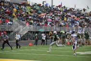 Senior Kyle Peters runs the ball in for a touchdown.
