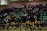 The volleyball team celebrates after scoring a point against Providence.