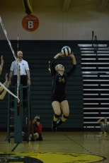 Junior Jacque Farris sets the ball for a teammate.