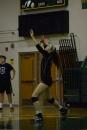 Senior Gwyn Jones serves the ball.