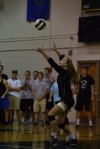 Freshman Sara Sans serves the ball to Providence.