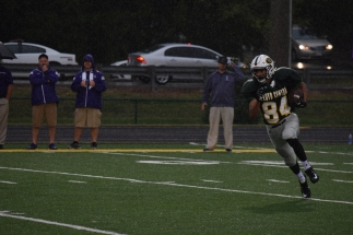 Junior Antonio Villegas carries the ball up the middle of the field.