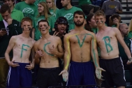 Seniors Keaton Jacobi, Tyler Thulier, Evan Rohde, and Jack Parker paint 'FCVB' on their chests to support Floyd Central volleyball.