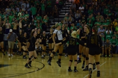 The volleyball team and the fans celebrate after they tie the set. The team went on to win the third set, but fell to the Pioneers in the fourth set therefore losing the match 3-1.