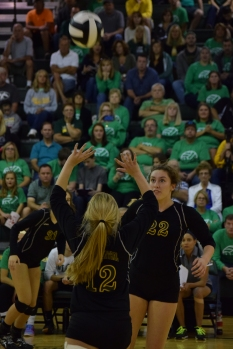 Freshman Sara Sans sets the ball for her teammate.
