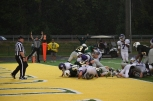 A group of Highlanders push the ball into the end zone for a touchdown. The Higlanders went up 21-0 after they scored.