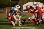 Junior Michael Sans is tackled by a group of Jeffersonville players.
