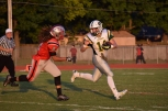 Senior Kyle Peters runs the ball past Jeffersonvile senior Chris Downs.