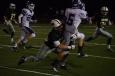 Senior Blake Carl makes a tackle on a Seymour player.