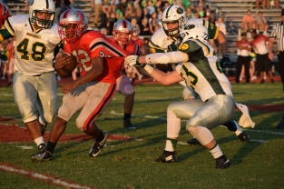 Senior Blake Carl pulls down Jeffersonville sophomore Tristain Nye.