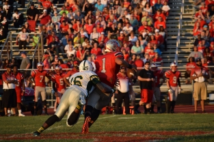 Junior Tyler Young sacks Jeffersonville junior Cam Northern in the backfield.