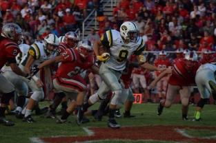 Sophomore Brandon Striegel runs the ball past the Jeffersonville defense.